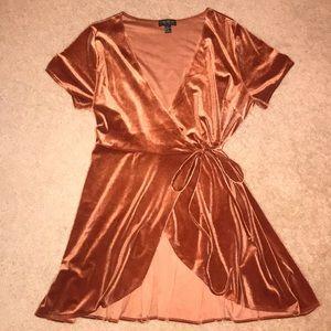 This is a, Burnt Orange velvet wrap dress.